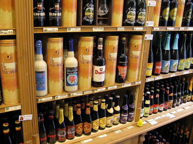 White and brown plastic bottles on brown wooden shelf