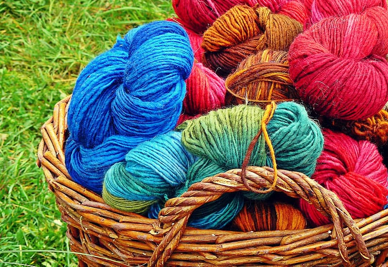 Assorted-colored yarns in basket