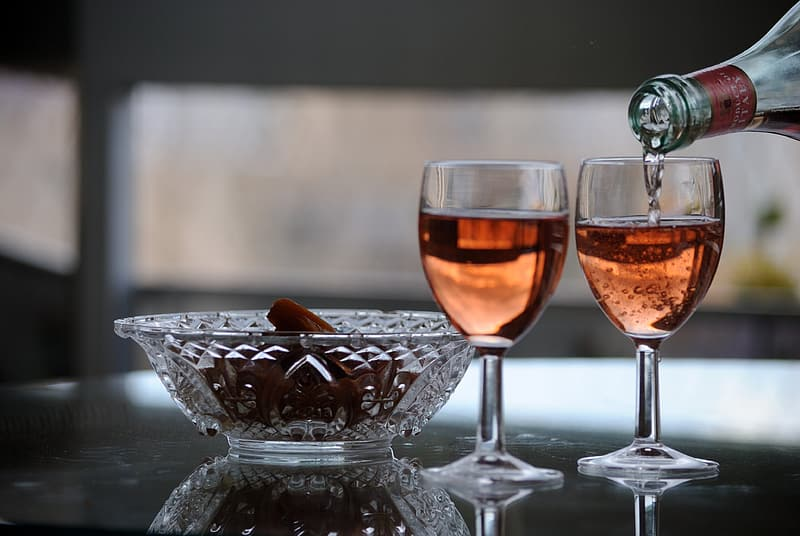 Photo of wine glass filled with liquid