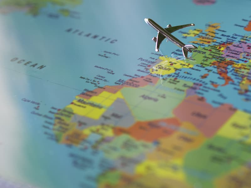 Airliner scale model flying over map selective focus photography