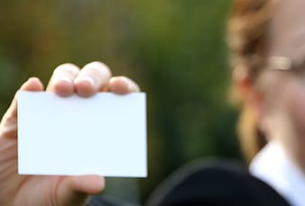 Person holding white card
