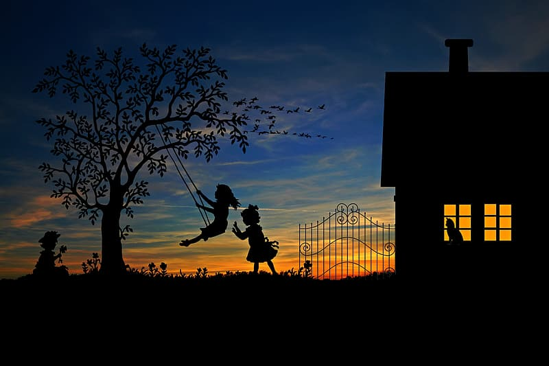 Silhouette of three girls playing outside at sunset