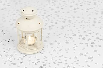 Candle lamp on polka star mat