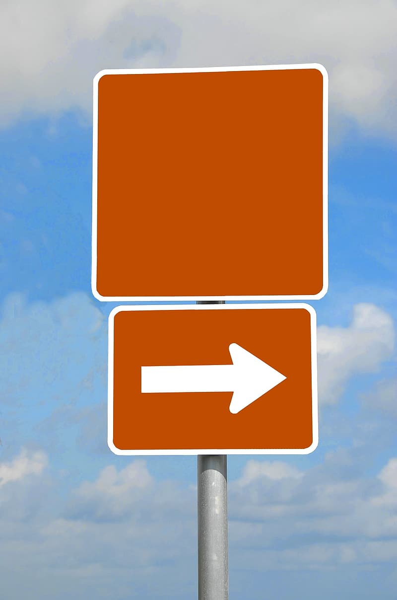 Orange and white arrow sign
