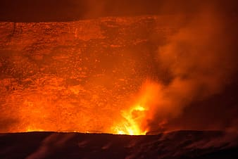 Photo of mountain spitting lava