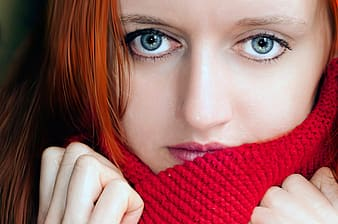 Woman with red hair wearing red knitted scarf