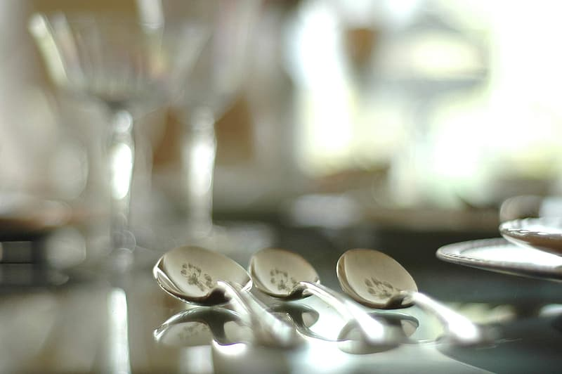Selective focus photography of three silver spoons