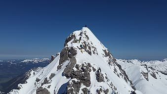 Person standing on mountain peak