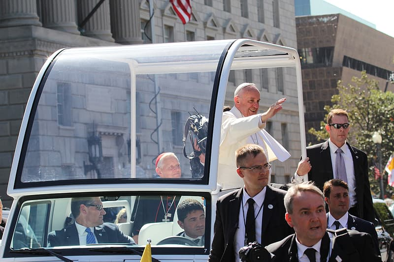 Pope Francis in white vehicle