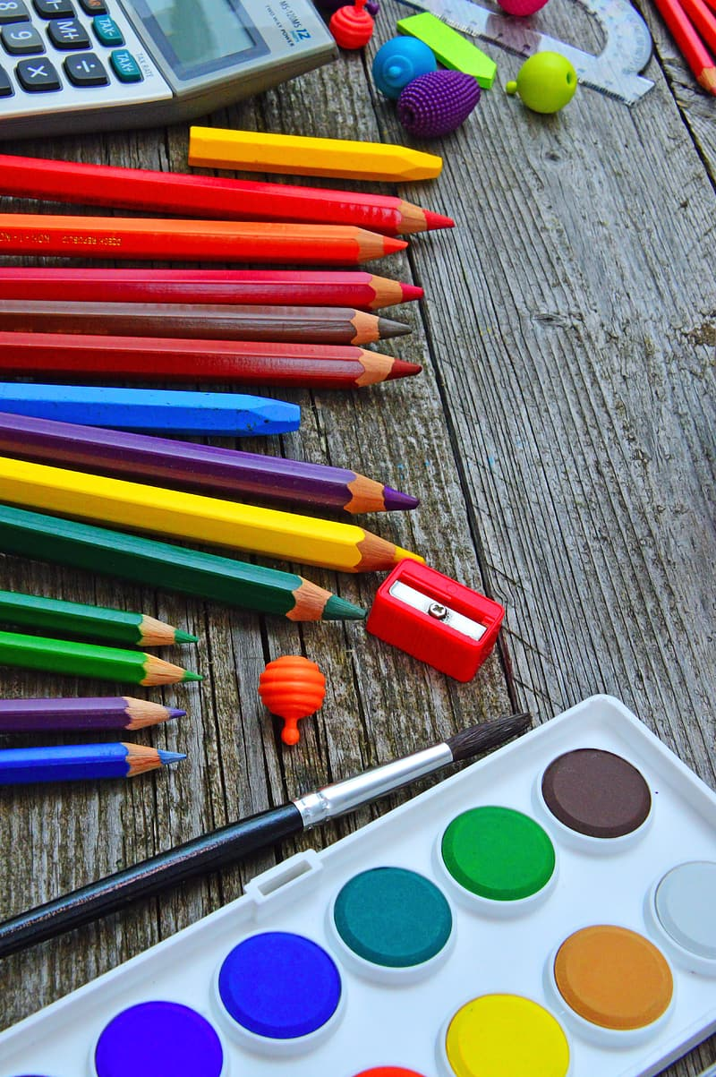 Coloring pencils on gray wooden table