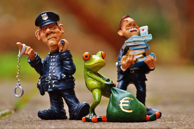 Two policemen and frog figurines