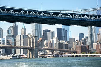 Low-angle photo of Brooklyn Bridge in New York at daytime