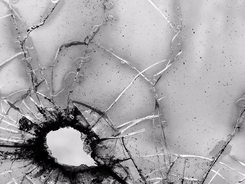 Grayscale close up photography of shattered glass