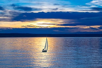Landscape photography of sailboat on body of water