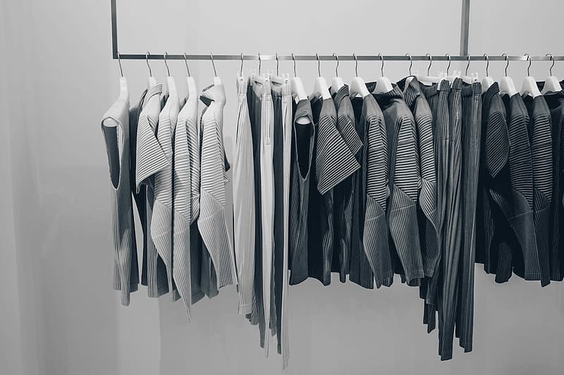 Grayscale photo of organized cloth lot