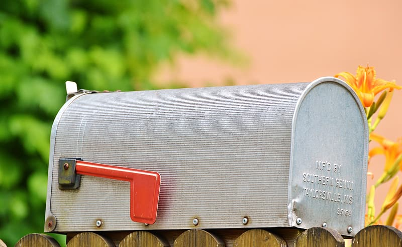 Gray and red metal mailbox close-up photo