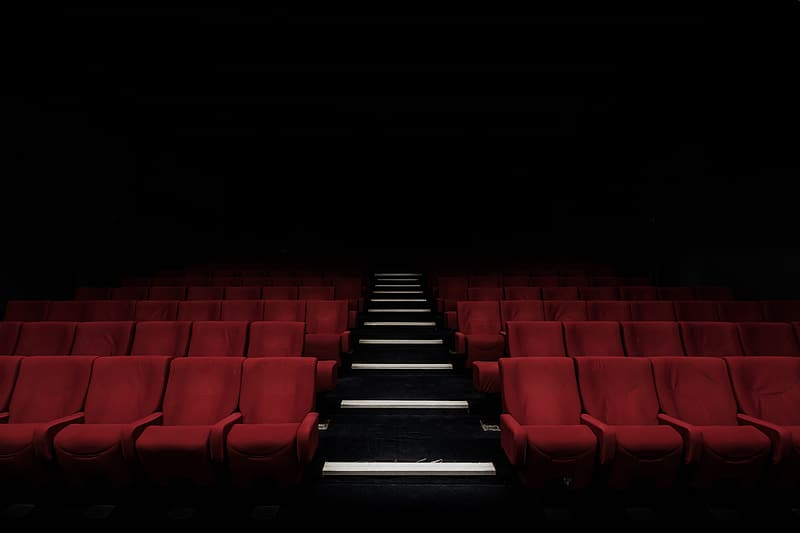 Low angle photography of red chairs on theater