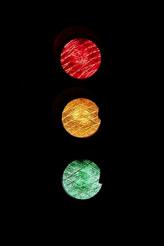 Traffic light with red, yellow, and green lights on