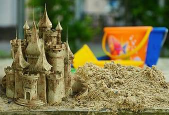 Shallow focus photography of sand castle