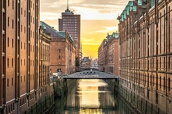 Canal between brown concrete building