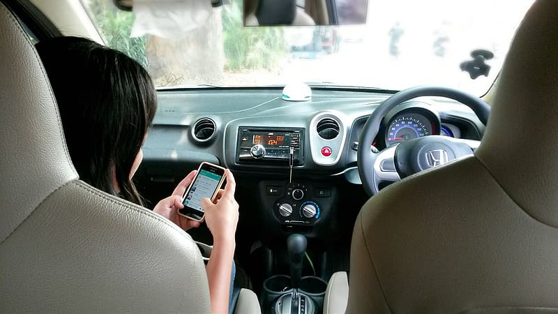 Person texting inside the car during daytime