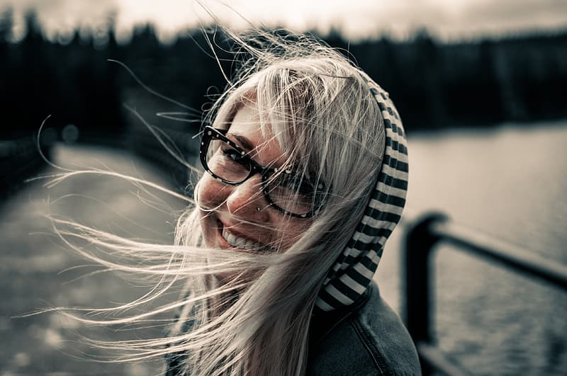 Woman wearing black and white striped hoodie