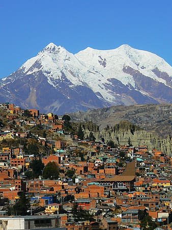 City near the snow capped mountain