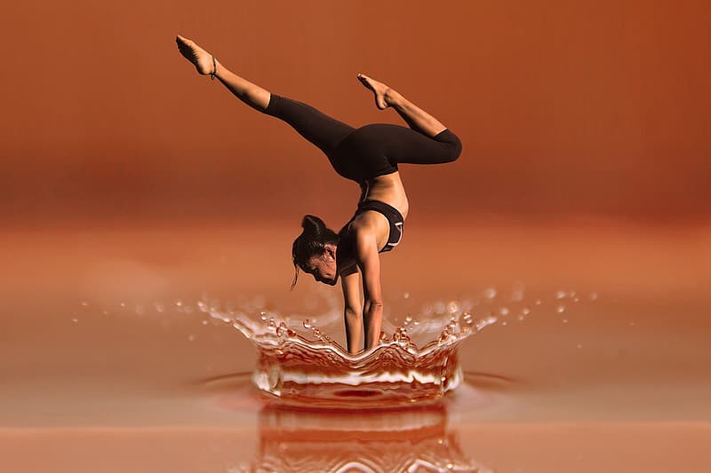 Shallow focus photography of woman doing yoga
