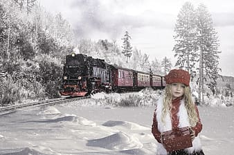 Girl in red hat and white jacket standing on snow covered ground