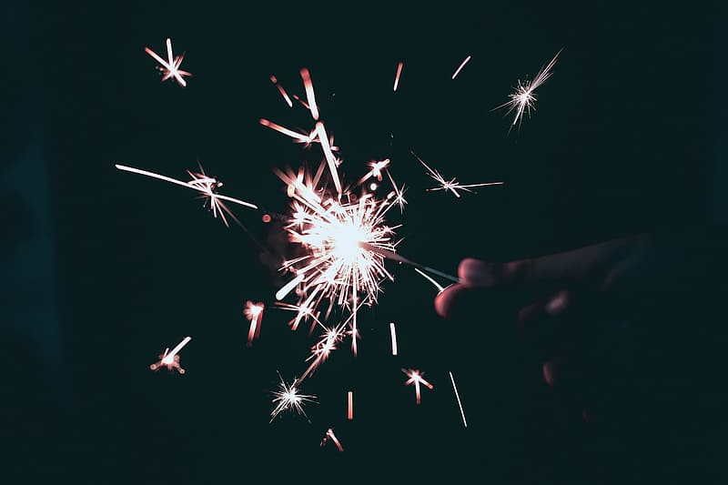 Person holding white and red fireworks