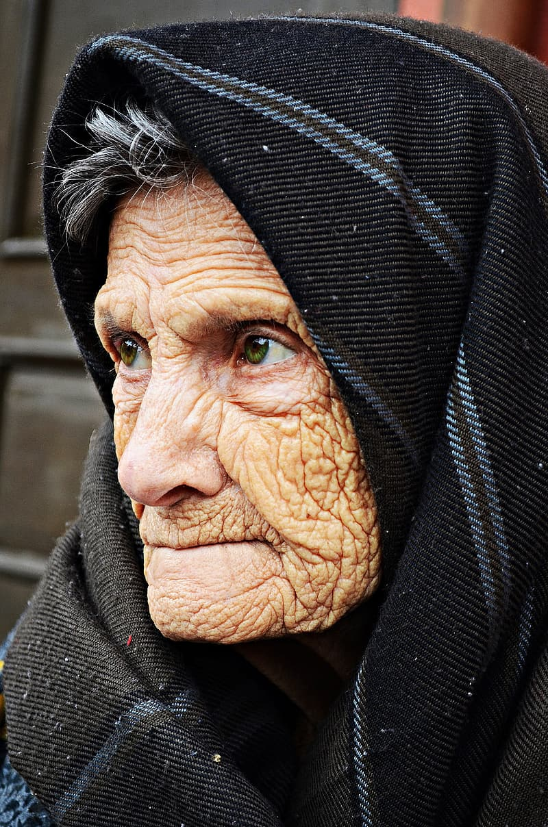 Woman in black and gray headscarf