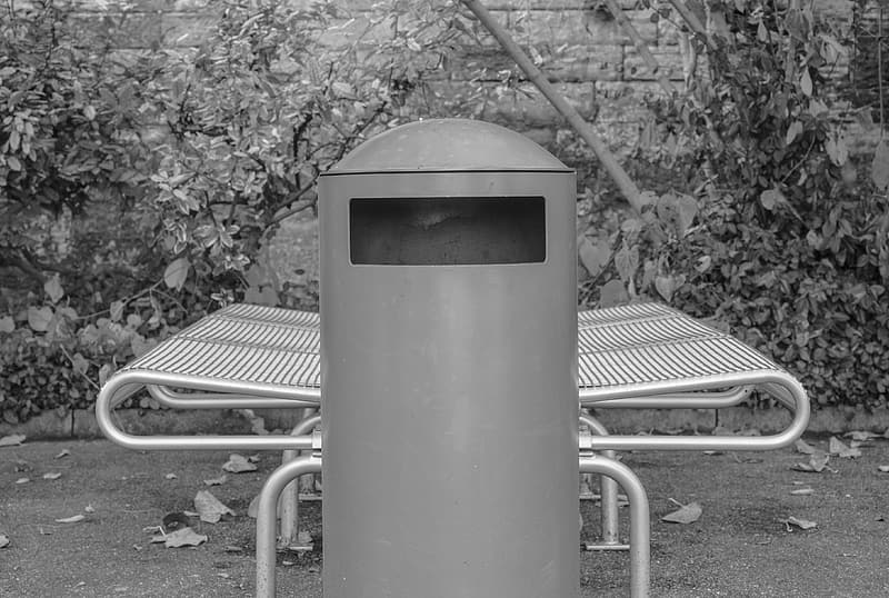 Grayscale photo of metal post
