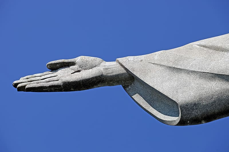 Close-up photo of Jesus Christ statue's right hand