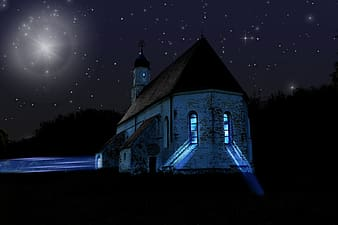 White and brown church during nighttime