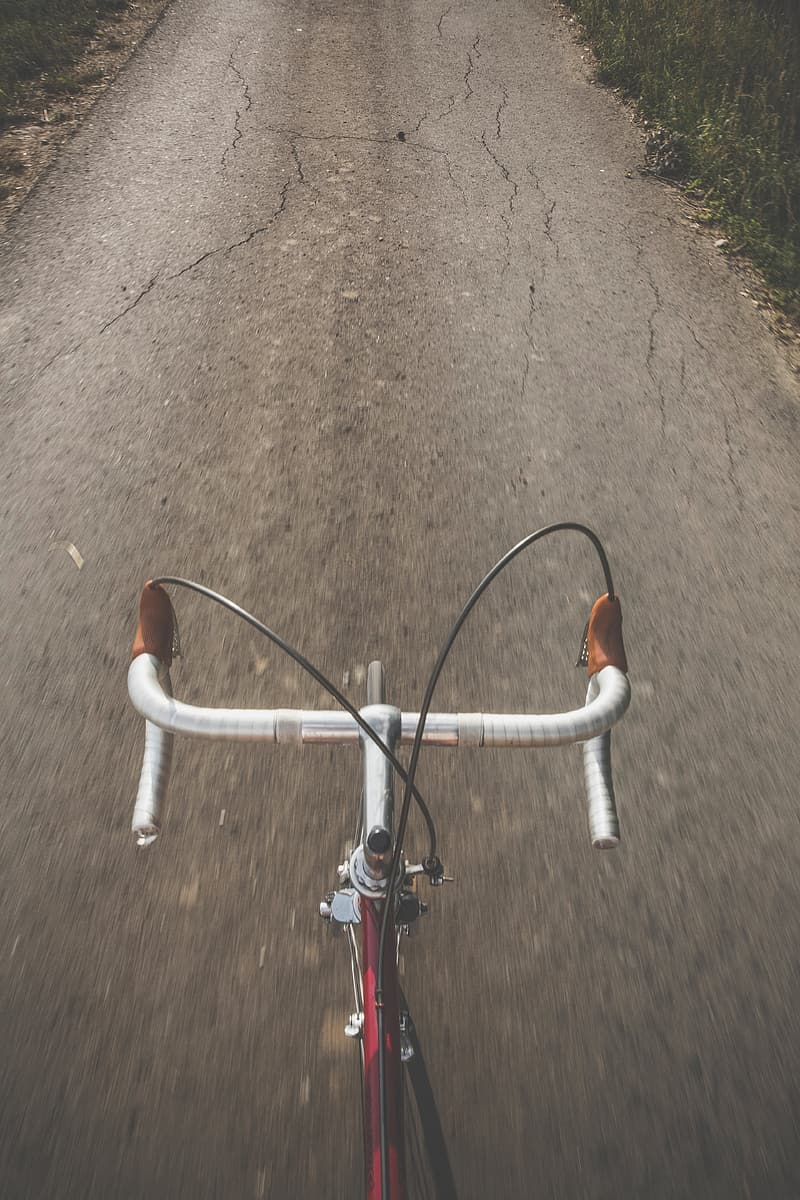 Red and white bicycle on brown dirt