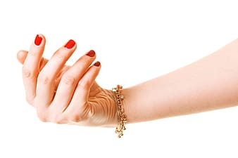 Woman with red manicure wearing gold bracelet