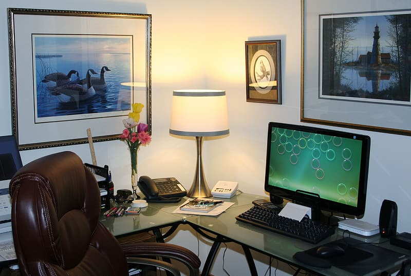 Flat screen computer monitor with keyboard and table