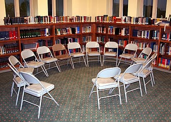 Circle of folding chairs inside room