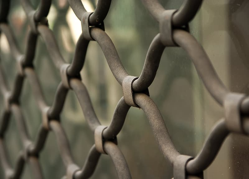 Close up photography of gray cyclone fence