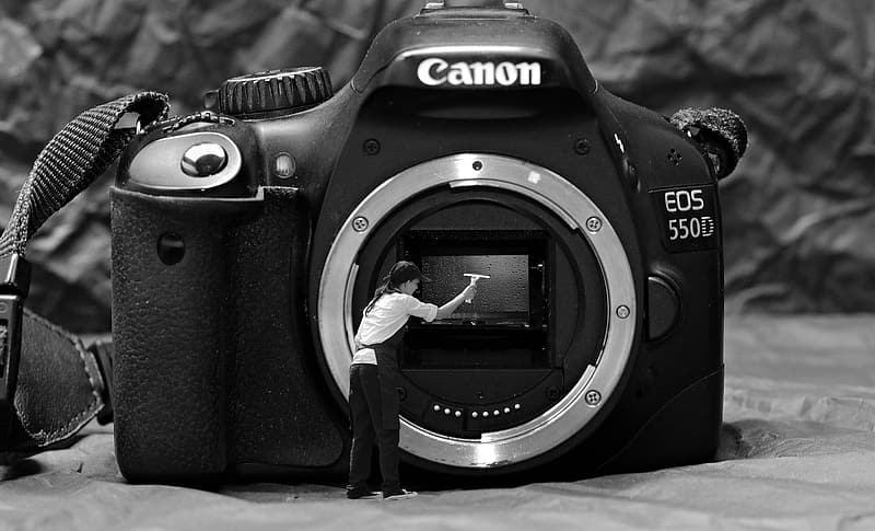 Grayscale photography of Canon EOS 550D camera