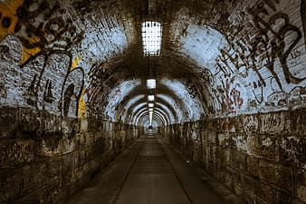 Gray and brown concrete tunnel