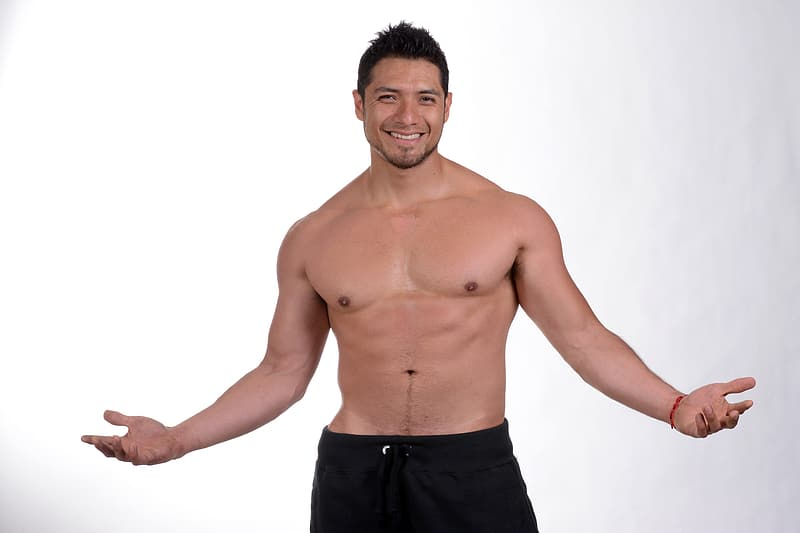 Topless man in black shorts