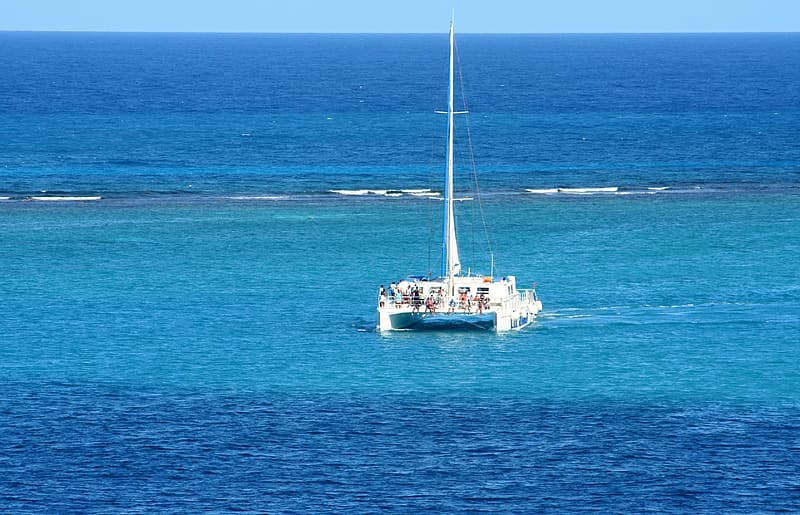 White sailboat on open water during daytime