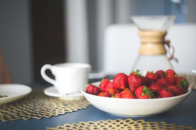 Bunch of red strawberries in plate
