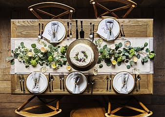 Assorted kitchenware on brown wooden dinning table