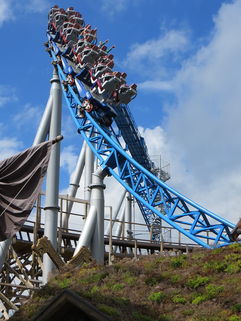 Group of people riding on roller coaster during daytime