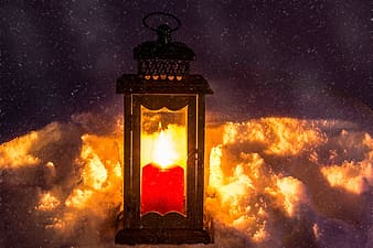 Candle lantern with clouds background