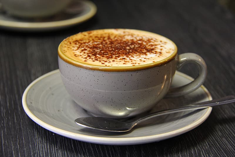 White ceramic cup with brown liquid
