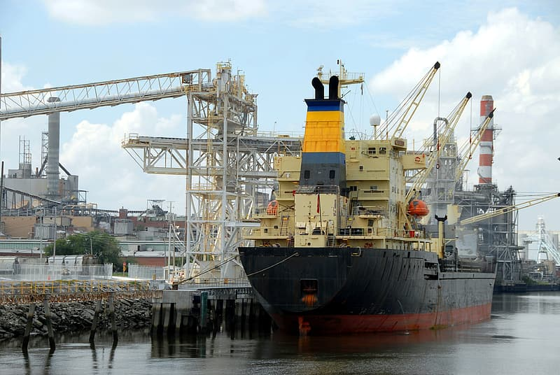 Yellow and black cargo ship on sea during daytime