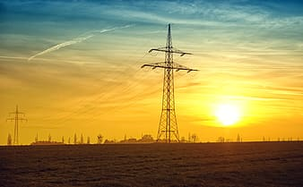 Gray transmission tower during golden hour